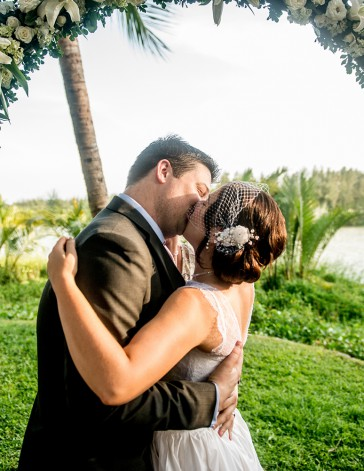 Tropical Riverside Wedding with White Flower Arch   Hoi An, Vietnam